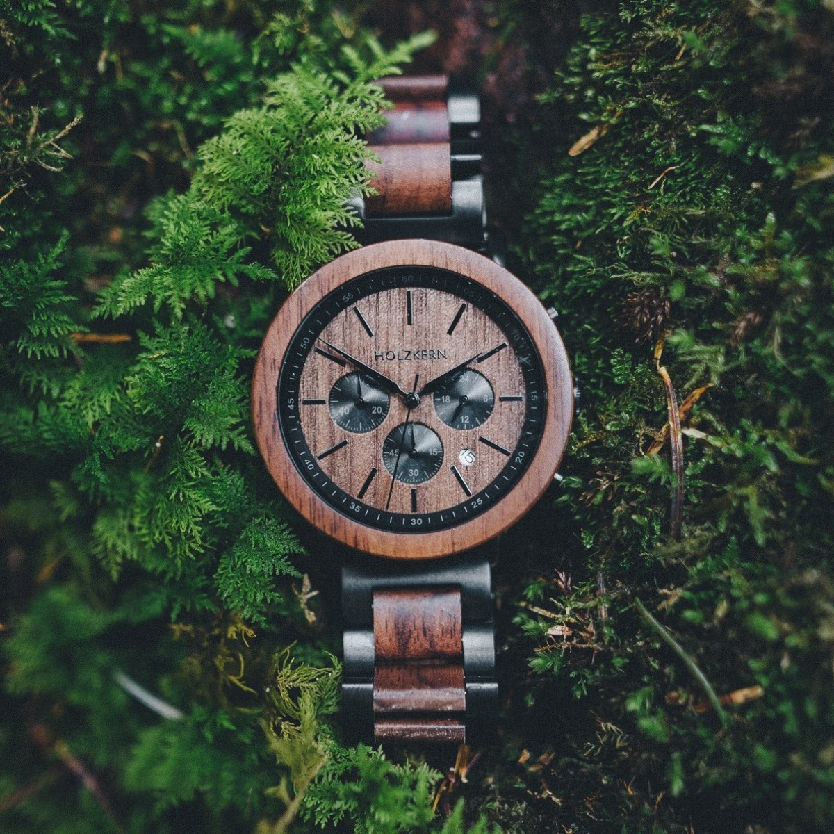 The wood watch Dusk surrounded by greenery