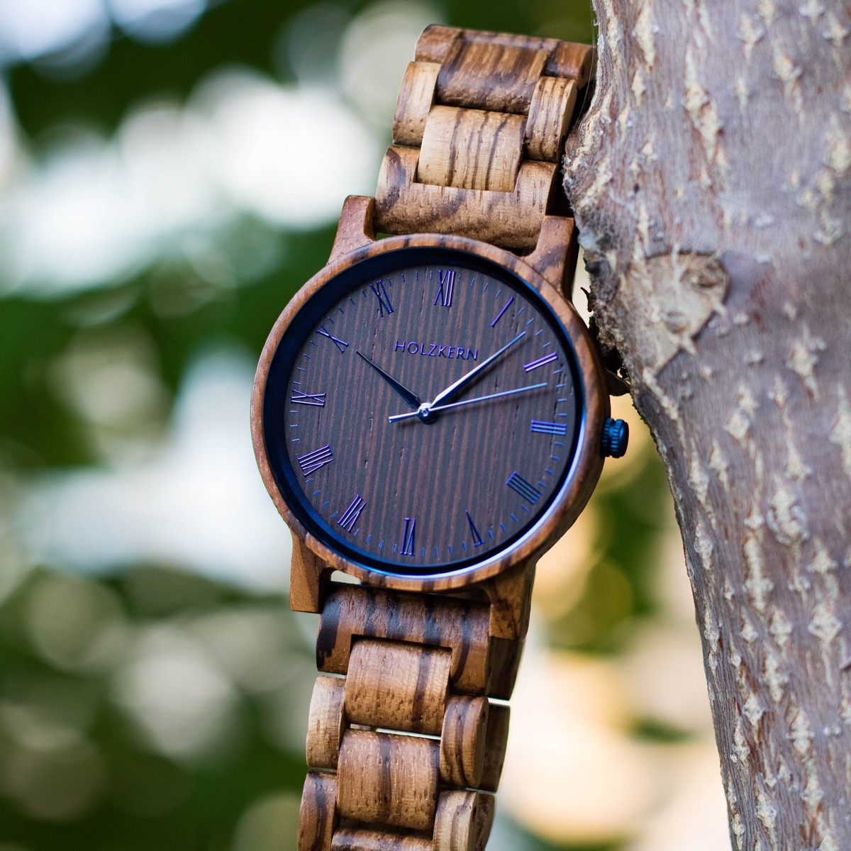 Holzkern wooden watch Fall Morning hanging in a tree
