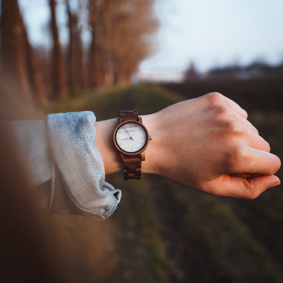 A woman's wrist with the wood watch Air from Holzkern