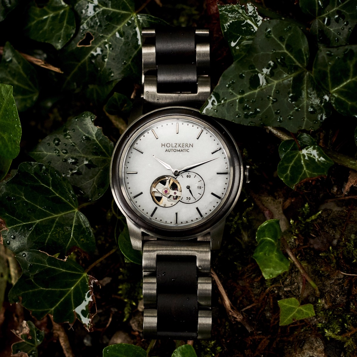 Mens wood watch Manhattan in between ivy leaves