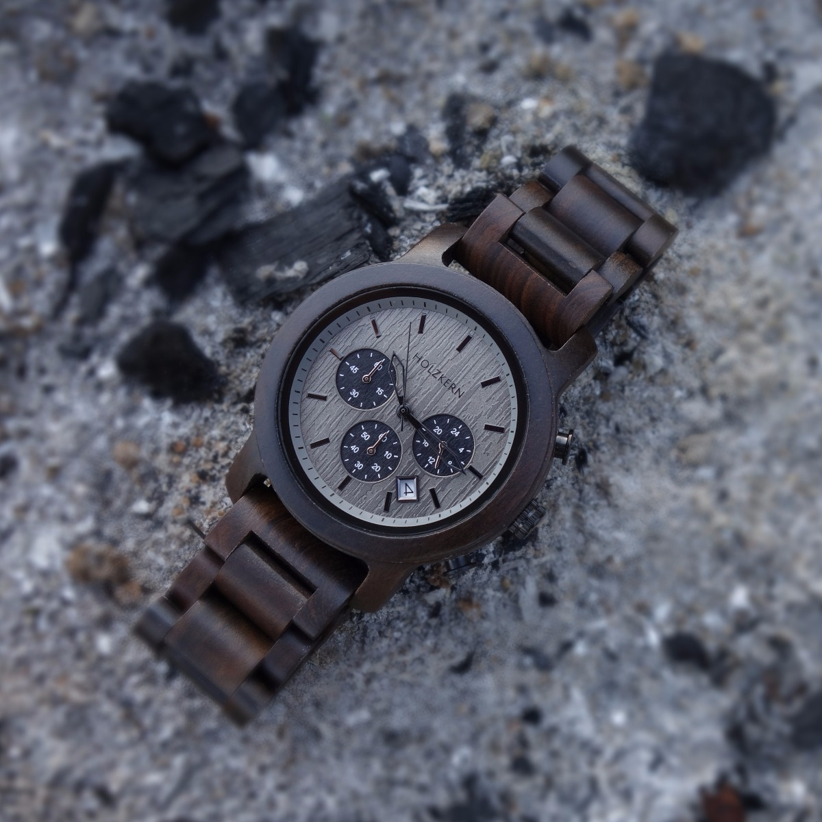 Holzkern's wood watch Northwall made of leadwood lying on rocks