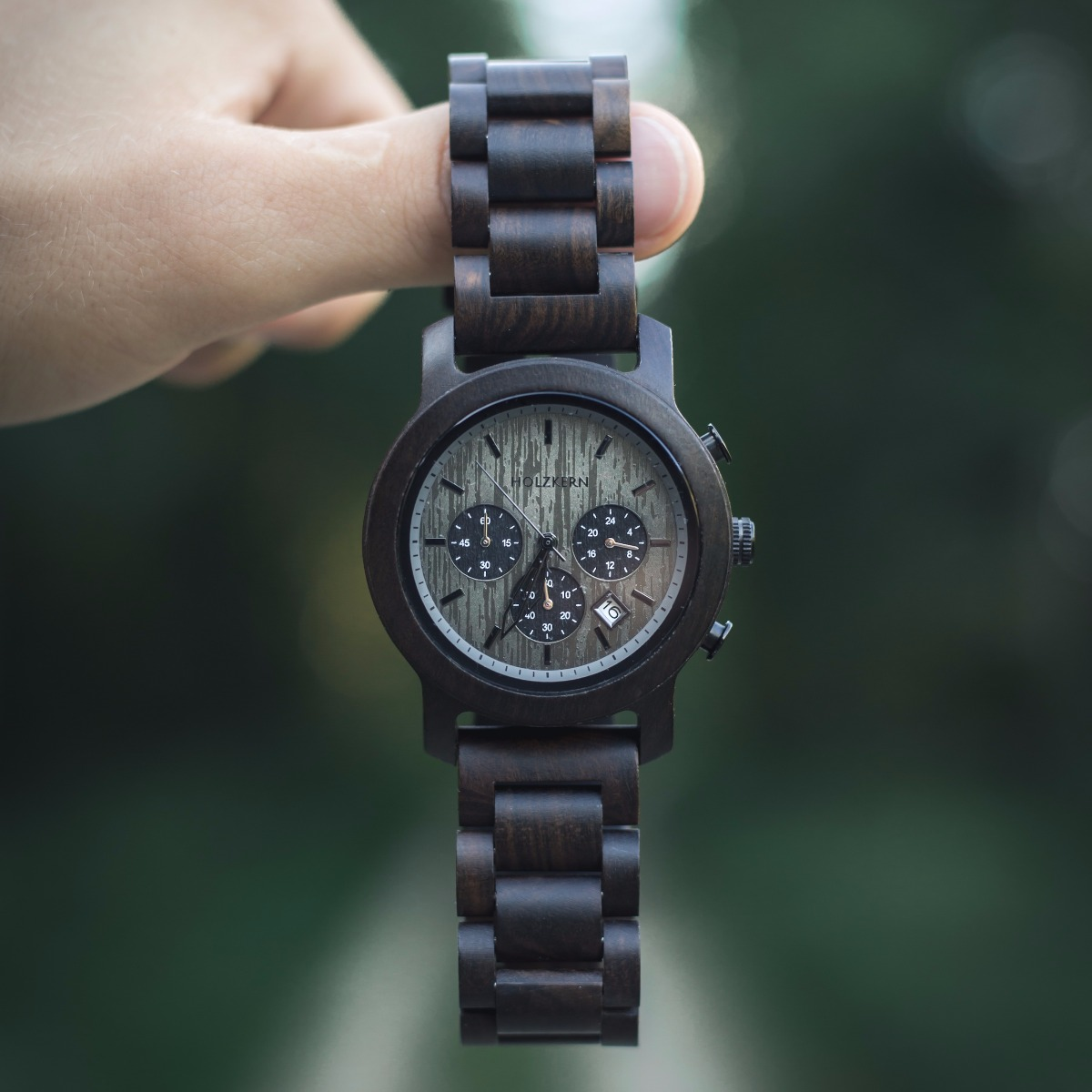 A man holding the wooden watch Northwall by Holzkern
