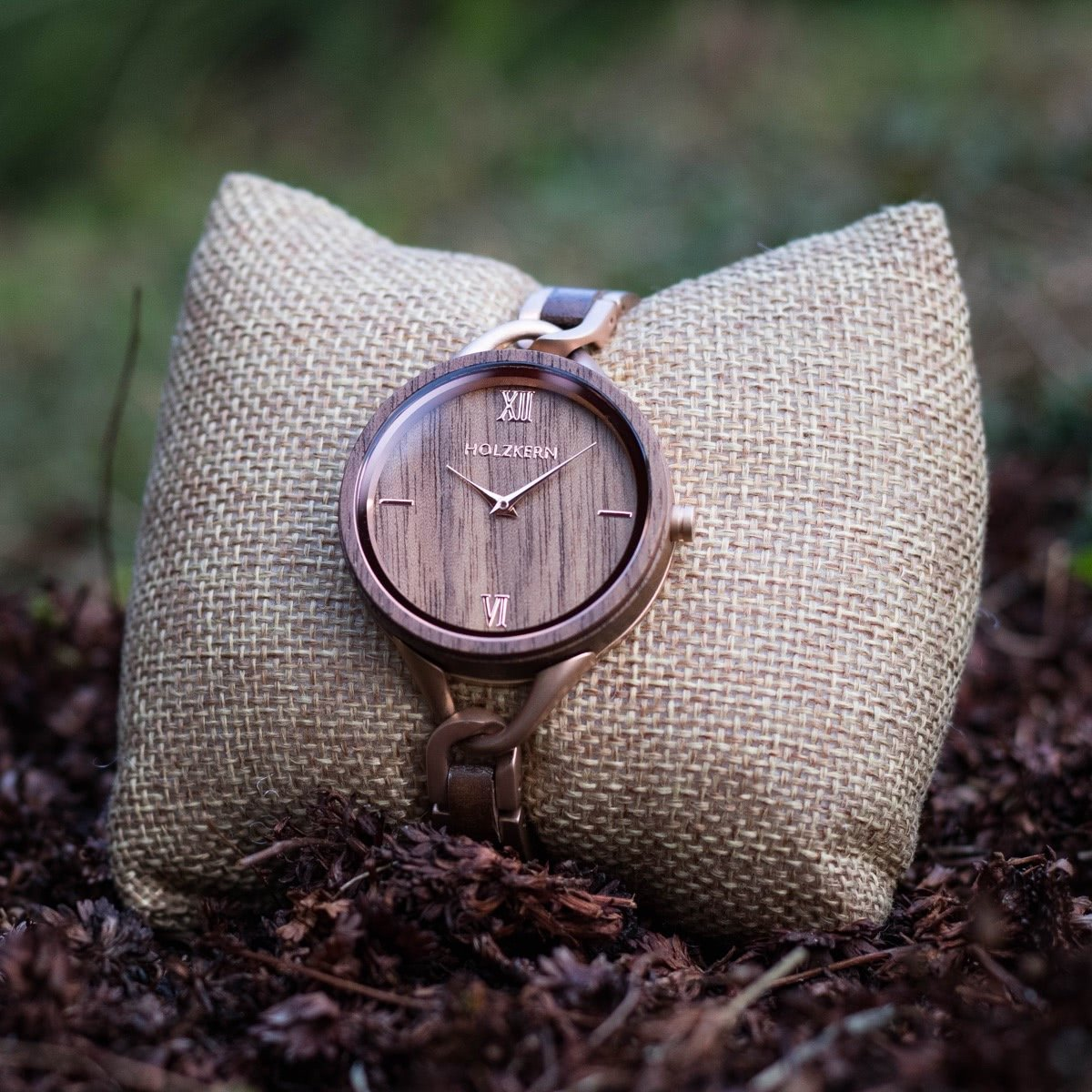 Ladies wood watch silk fiber on a jewellery cushion